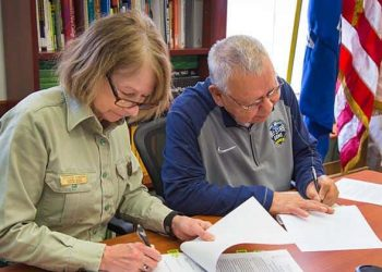 "U.S. Forest Service Eastern Regional Forester Kathleen Atkinson and FCP Chairman Harold ""Gus"" Frank sign the MOU."